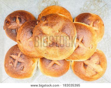 Pumpkin seed buns on baking paper after baking