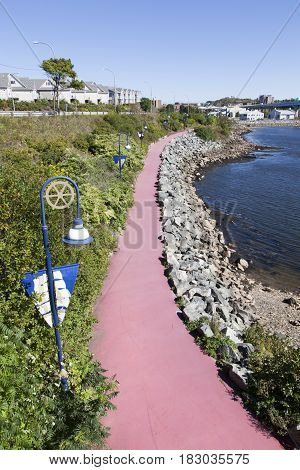 The red color Harbour Passage Trail in Saint John town (New Brunswick Canada).