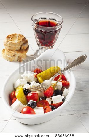greek salad with feta cheese and wine