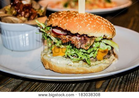 Sandwich hamburger with juicy burgers cheese and mix of vegetables