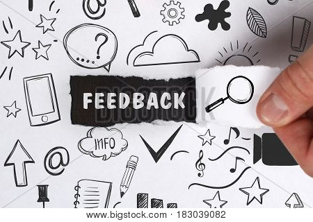 Business, Technology, Internet And Network Concept. Young Businessman Shows The Word: Feedback