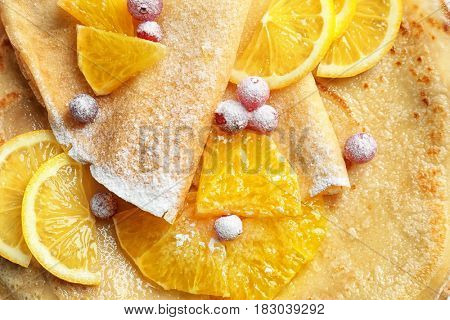 Delicious pancakes with orange and  cranberry, closeup