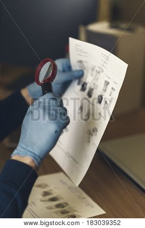 Detective examines samples fingers trace got at the scene of the crime. Ukraine