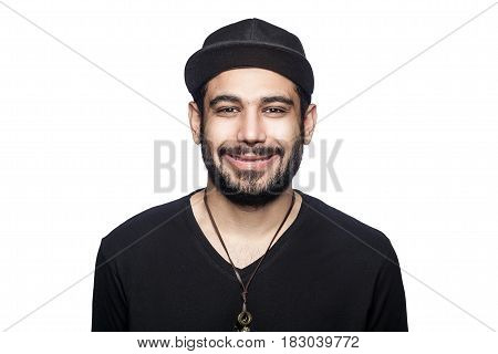 Portrait of young happy smilely man with black t-shirt and cap looking at camera with toothy smile. studio shot isolated on white background.