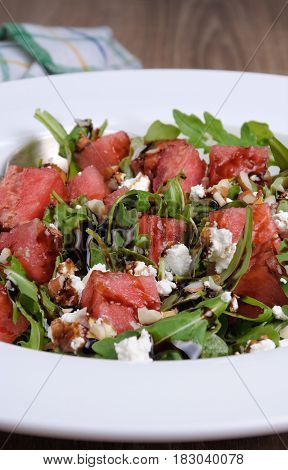 Arugula salad ricotta cheese with watermelon slices balsamic soy sauce