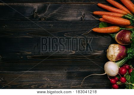 Organic Vegetables Background. Fresh Harvested Vegetables On The Dark Wooden Background, Top View, W