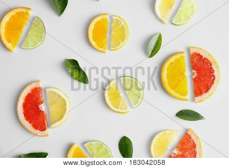 Composition of fresh slices of citrus fruits on white background