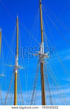 Yacht mast against blue summer sky .