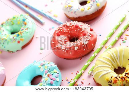 Tasty Donuts With Sprinkles And Tubules On Paper Background