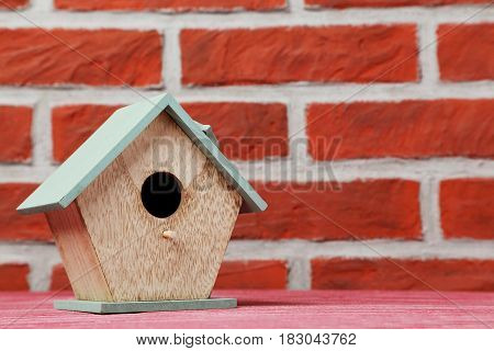 Wooden Nesting Box On The Brick Wall Background