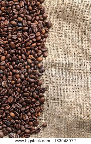 Brown roasted coffee beans on the sackcloth