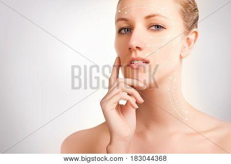 gorgeous blue eyed blonde model portrait with skin surgery mark isolated on white background