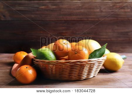 Beautiful composition of tropical fruits on wooden table