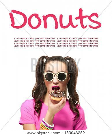 Young woman with tasty donut on white background