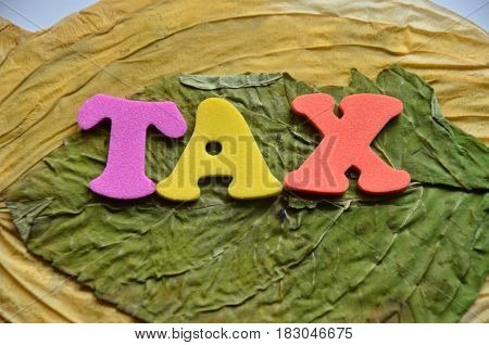 word tax on a  abstract colorful backgrouynd