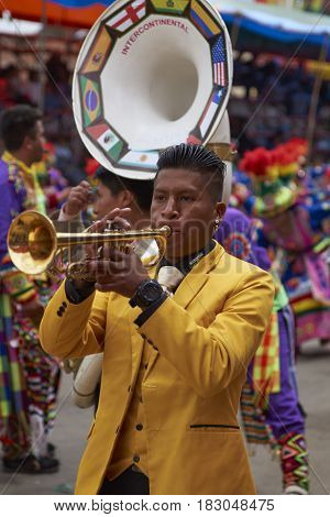 ORURO, BOLIVIA - FEBRUARY 26, 2017: Tinkus dancers in colourful costumes performing at the annual Oruro Carnival. The event is designated by UNESCO as being Intangible Cultural Heritage of Humanity.