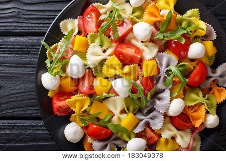Multicolored Farfalle Pasta With Tomatoes And Mozzarella Close-up. Horizontal Top View