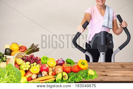 Woman with elliptical trainer