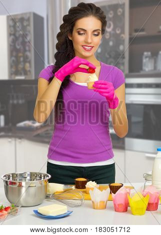 Young cooking woman in the kitchen