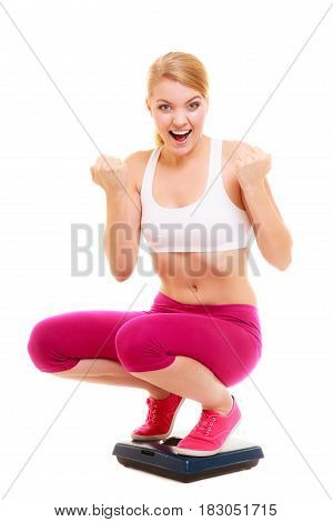 Happy Successful Woman Weighing Scale. Dieting.