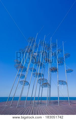 THESSALONIKI GREECE - OCTOBER 12 2016: The sculpture Umbrellas by George Zongolopoulos are located at the New Beach in Thessaloniki Greece