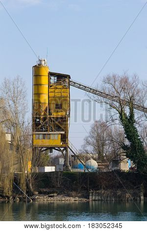Stone Quarry With Yellow Silo