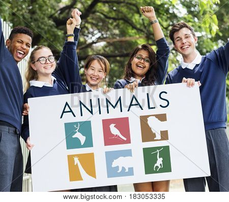 Students holding save animals banner