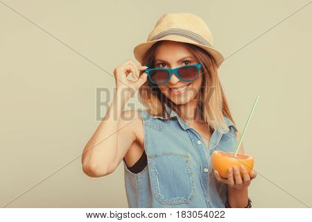 Happy Woman In Hat And Sunglasses With Grapefruit.