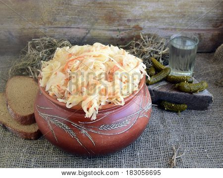 Cabbage fermented pickles bread and vodka are on a table. Traditional national Russian drink and snack.