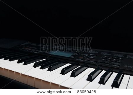 Keys of the digital synthesizer on a black background