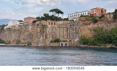 View of cliff coast in Sorrento town in southern Italy at dusk
