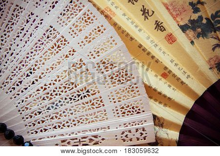 bright background with japanese handmade fans closeup