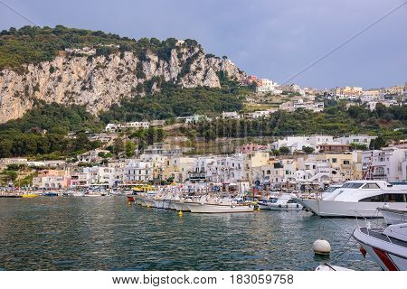 Boats moored at Marina Grande on famous italian island of Capri at sunset Campania Italy