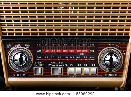 closeup retro styled radio with dial scale, knobs and buttons