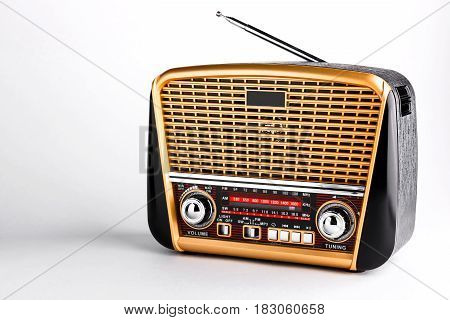 modern retro styled radio receiver with audio player on white background
