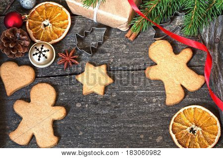 Vintage Christmas background with the gingerbread cookies