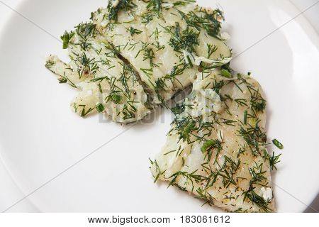marinated cod willet with dill closeup on plate