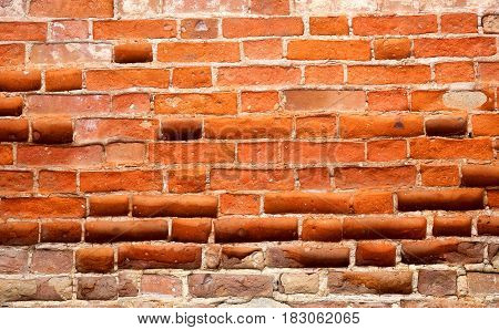 Photo of a brightly colored old brick building wall