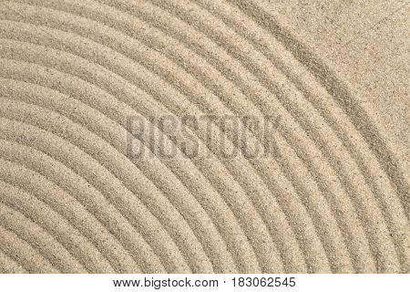 Sand texture with a circle patters close up