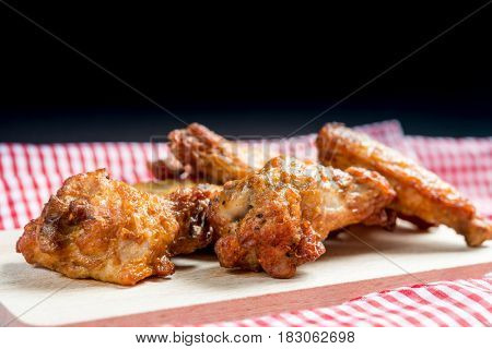 delicious fried chicken wings on table