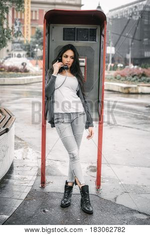 Fashion Woman Talking In The Retro Phone Booth