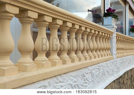 Stone balustrade railing in beige facade architectural