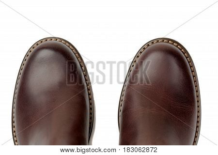 Brown leather shoes close-up top view isolated on a white background