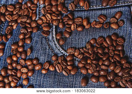 black coffee beans on a old jeans background