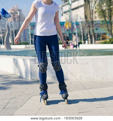 young Roller Girl is learning how to skate. First time on roller skates.