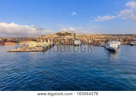 Port of Naples Italy in Europe with boats in the harbor and buildings in the background.