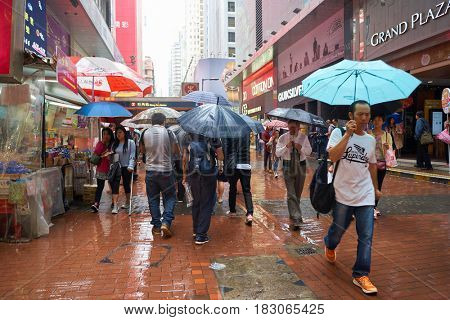 HONG KONG - CIRCA NOVEMBER, 2016: people walking on Hong Kong street on rainy day