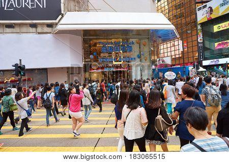 HONG KONG - CIRCA NOVEMBER, 2016: crowd of people walking crossing road in Hong Kong.