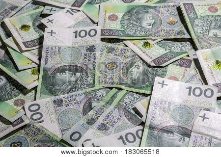 polish money background. one hundred zlotys. banknotes