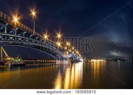Beautiful sunset night over Rhine / Rhein river and old bridge in Mainz near Frankfurt am Main Germany.
